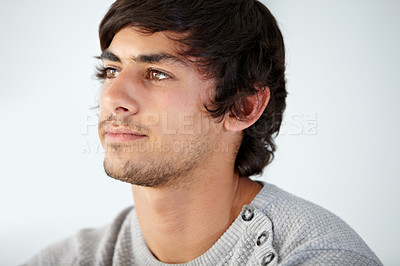 Buy stock photo Cropped view of a young man looking away thoughtfully