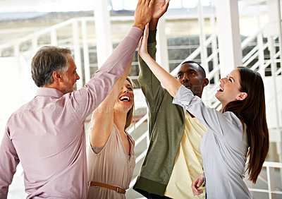 Buy stock photo Four business colleagues having a good time working together