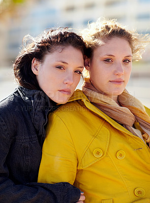 Buy stock photo Portrait of two sister's standing outside