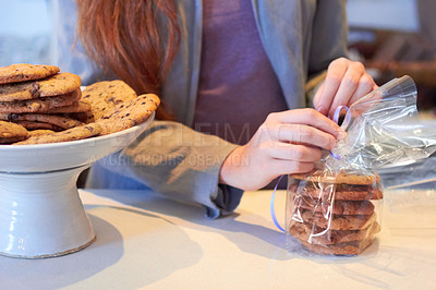 Buy stock photo Cropped shot of a woman working in her bakery