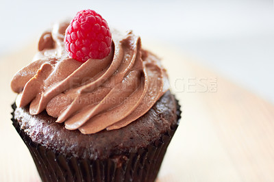 Buy stock photo Cropped shot of a freshly baked cupcake