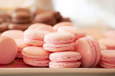 Buy stock photo Cropped shot of a fresh batch of pink macaroons