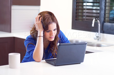 Buy stock photo A young woman looking frustrated while working on her laptop