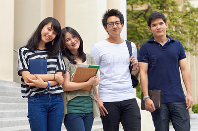 Buy stock photo Four young students leaving camous