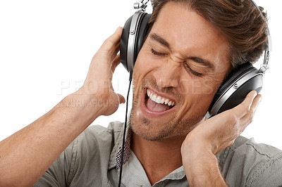 Buy stock photo A handsome young man listening to music with his eyes closed