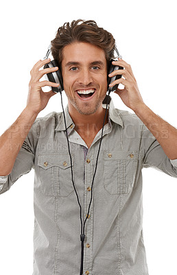 Buy stock photo Portrait of a handsome young man listening to music