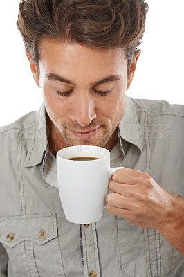Buy stock photo A handsome young man enjoying the aroma of a fresh cup of coffee