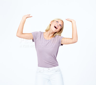 Buy stock photo Pretty young woman gesturing to have a heavy weight above her head