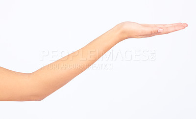 Buy stock photo Cropped image of a hand presenting what could be your product