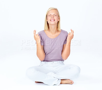 Buy stock photo Cute young woman crossing her fingers in hope