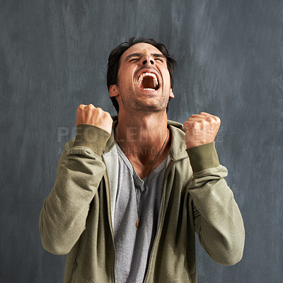 Buy stock photo A young man yelling in frustration with his eyes closed