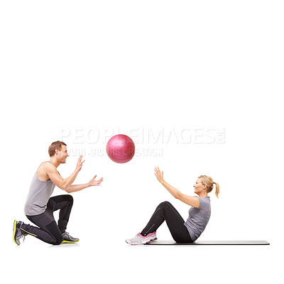 Buy stock photo A man and woman exercising their abs by passing a medicine ball to each other