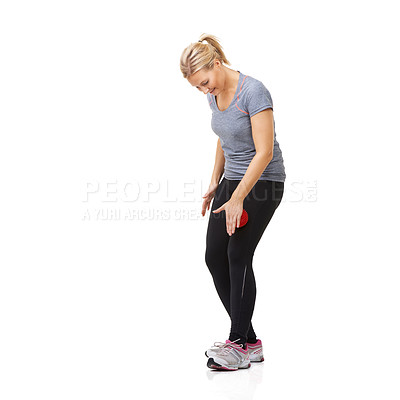 Buy stock photo A young woman getting in shape using an exercise ball