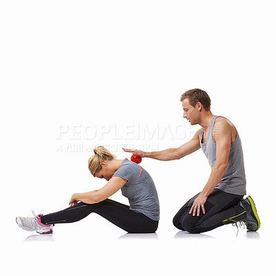 Buy stock photo A young man using a massage ball on his female friend's back