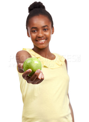 Buy stock photo Portrait of a young african american girl offering an apple to the camera isolated on white