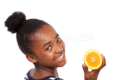 Buy stock photo Studio portrait of a happy young african american girl holding an orange half isolated on white