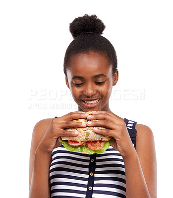 Buy stock photo Shot of a happy young african american girl holding a vegetable sandwich isolated on white