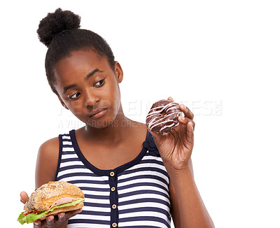Buy stock photo Shot of a young african american girl trying to choose between eating a donut or a sandwich