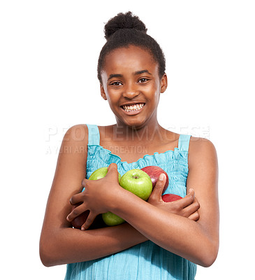 Buy stock photo Studio shot of a happy-looking young african american girl carry a pile of apples in her arms isolated on white