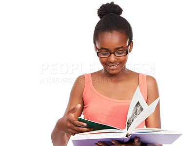 Buy stock photo Studio shot of a young african american girl reading a book and wearing glasses isolated on white