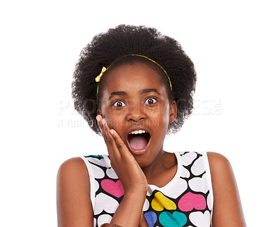 Buy stock photo Studio portrait of a shocked-looking young african american girl with her hand on her cheek isolated on white