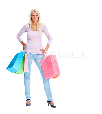 Buy stock photo Full length image of a young female holding her shopping bags isolated on white