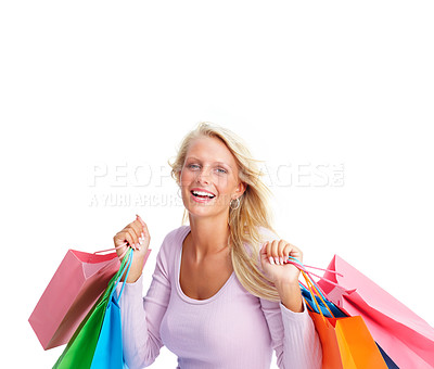Buy stock photo Happy young woman holding shopping bags over white background