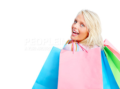Buy stock photo Cheerful young woman holding colorful shopping bags over white