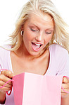 Surprise - Closeup of a young blond with a shopping bag