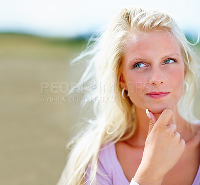Buy stock photo Day dreaming: Young model smiling while in a field