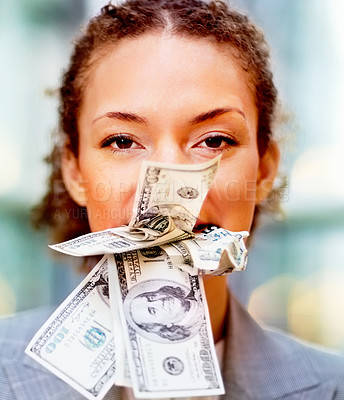 Buy stock photo Young business woman being bribed with money in her mouth