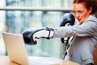 Buy stock photo Young African American business woman wearing boxing gloves during work