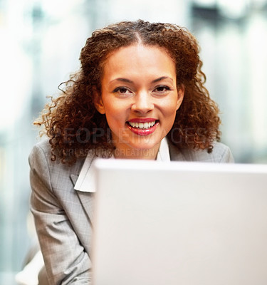Buy stock photo Cute African American business woman working on the laptop