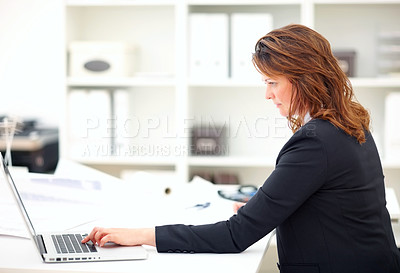 Buy stock photo Executive business woman working on a laptop in the office