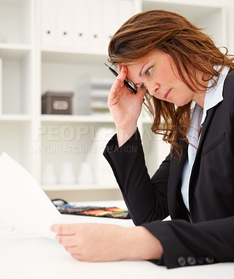 Buy stock photo Business woman in tension on going through documents