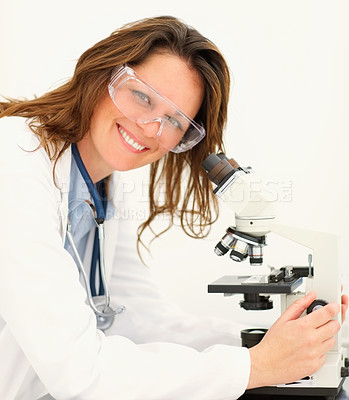 Buy stock photo Portrait of a happy medical woman researching on a microscope