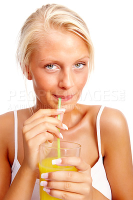 Buy stock photo Beautiful young woman sipping juice with a straw on white background