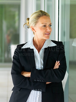 Buy stock photo Confident middle age business woman in black suit, looking away