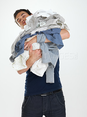 Buy stock photo Portrait of a tired young guy holding clothes isolated on white  background