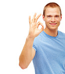 Young smart man indicating OK sign over white background