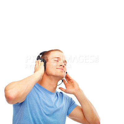 Buy stock photo Young smart man listening music isolated on white