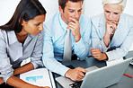 Group of businesspeople together working on laptop