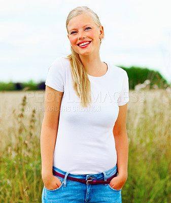 Buy stock photo Beautiful young woman posing at a field