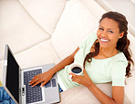 Top view of an African American girl using laptop, at h