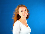 Smiling casual girl on blue background
