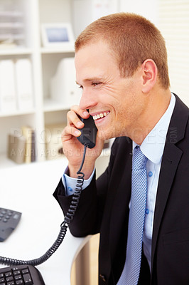 Buy stock photo Portrait of a smiling young business man communicating on telephone