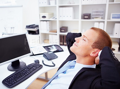 Buy stock photo Portrait of a young business man relaxing in the office