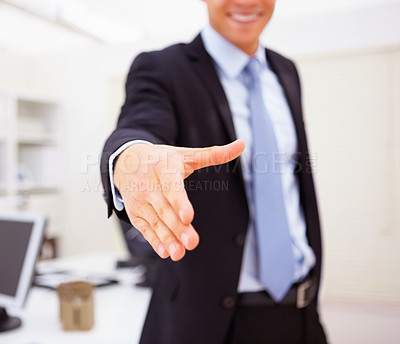 Buy stock photo Mid section image of a business man stretching out his hand to shake hand with someone