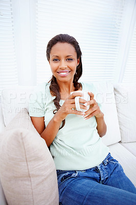 Buy stock photo Portrait of a cute African American female relaxed at home, having a cup of coffee