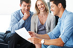 Consultant discussing investment plan with young couple